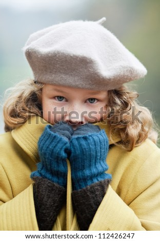Blond girl freezing up in a cold autumn day - stock photo