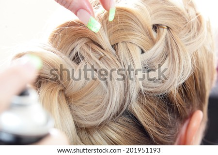 blond girl hair cut in european beauty salon - stock photo