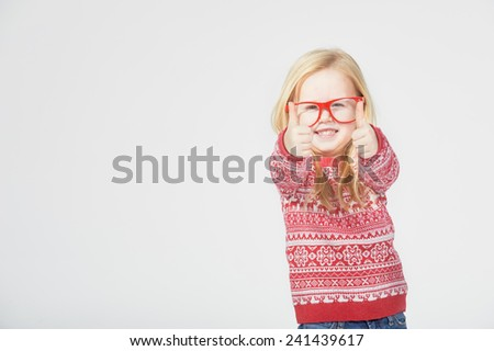 Blond girl in red glasses and a sweater - stock photo