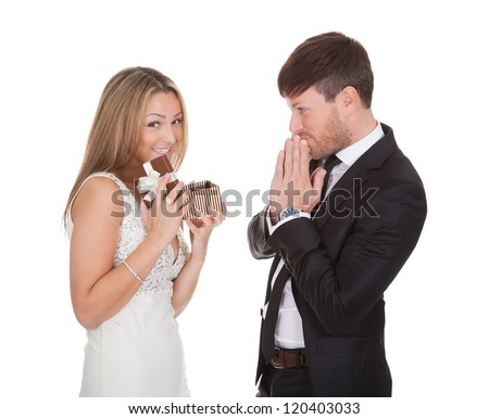 Blond girl opens present received from shy guy - stock photo