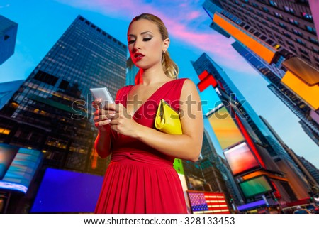 Blond girl red dress smartphone chat writing in Times Square of New York Photomount - stock photo