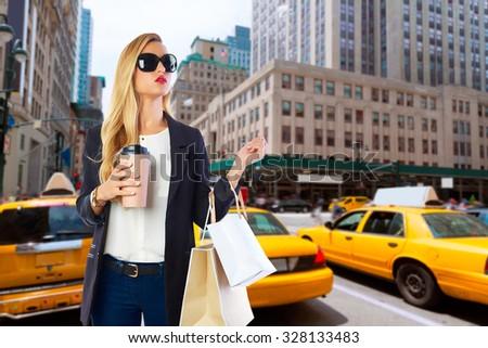 Blond girl shopaholic in Manhattan New York shopping with coffee Photomount - stock photo