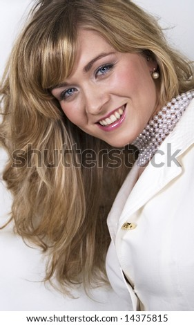 Blond girl with pearls - stock photo