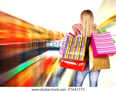 Blond girl with shopping bags - stock photo