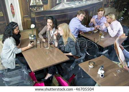 Blond guy being attracted to a blond girl at a different table in a cafe - stock photo