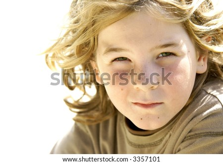 Blond hair blowing in the wind. - stock photo