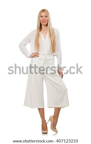 Blond hair model in elegant flared pants isolated on white - stock photo