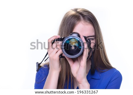 Blond haired woman taking a photo with a camera on a white background - stock photo