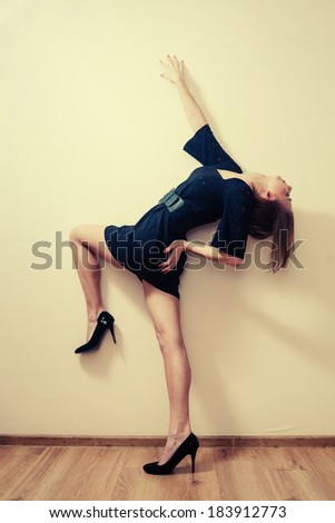 Blond haired women  posing in a fashion manner - stock photo