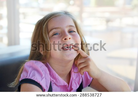 Blond happy kid girl showing her indented teeth portrait - stock photo