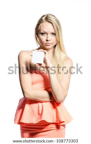 blond in pink with a white square card - stock photo