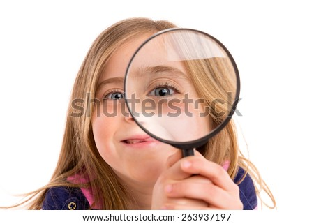 Blond indented girl with eye in magnifying glass funny expression on white background - stock photo