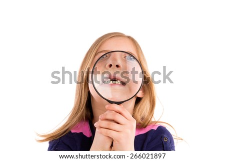 Blond indented girl with teeth in magnifying glass funny expression on white background - stock photo