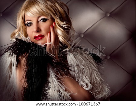 Blond lady looking like Marilyn Monroe - stock photo