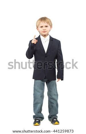 blond little boy raised his finger in a black jacket and jeans up and frowned, as if he was scolding someone. Isolated on white background. Shooting in the studio - stock photo