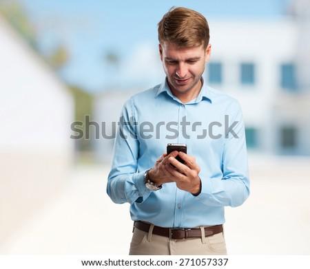 blond man speaking on phone - stock photo