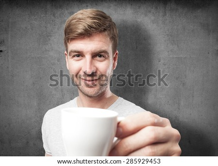 blond man with a coffee - stock photo