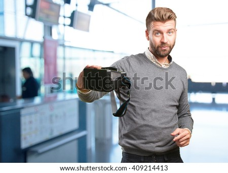 blond man with virtual glasses. surprised expression - stock photo
