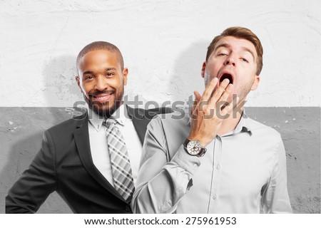 blond man yawning - stock photo