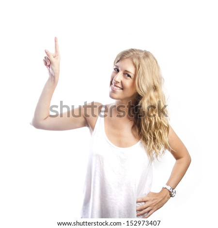 blond pretty woman pointing up - stock photo