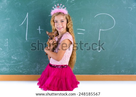 Blond princess schoolgirl holding pet chihuahua puppy dog in classroom green chalk board - stock photo