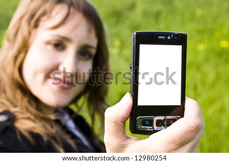 Blond smiling woman showing a black mobile phone. - stock photo