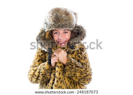 Blond winter kid girl cold freeze gesture expression with fur clothes fashion and cap - stock photo