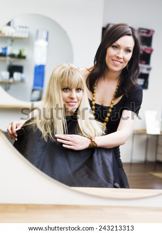 Blond woman at the Hair Salon - stock photo
