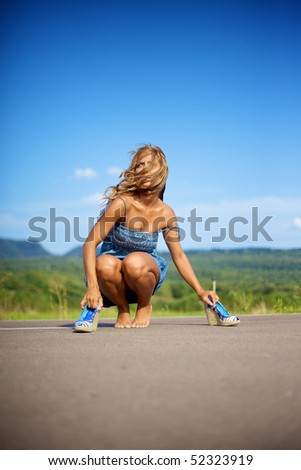 Blond woman barefeet on summer day - stock photo