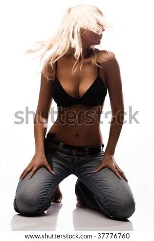 blond woman dancing on the floor, studio white - stock photo