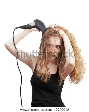 blond woman drying her hair with professional hair-dryer; beauty salon - stock photo