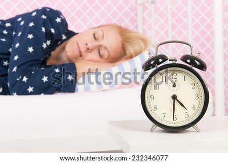 Blond woman having a good night in bed - stock photo