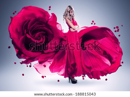 blond woman in long pink rose dress - stock photo