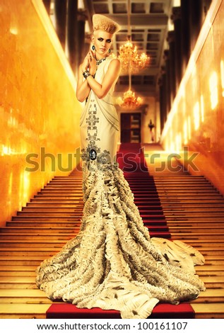 blond woman in long white dress on red carpet - stock photo
