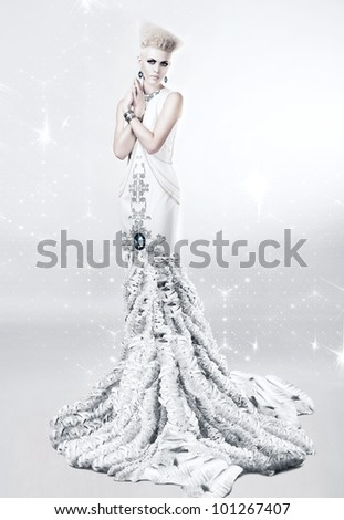 blond woman in long white dress with diamond - stock photo