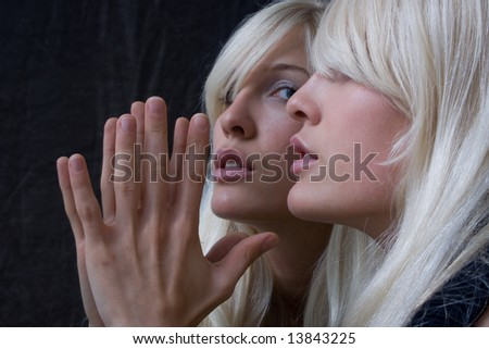 blond woman in the mirror - stock photo