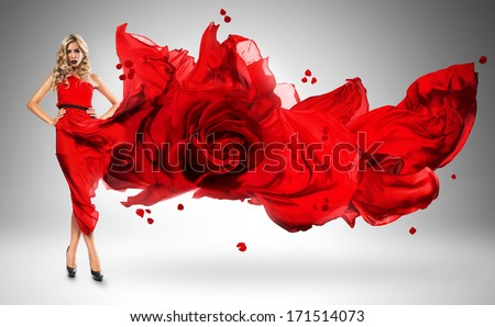 blond woman in windy red rose dress - stock photo
