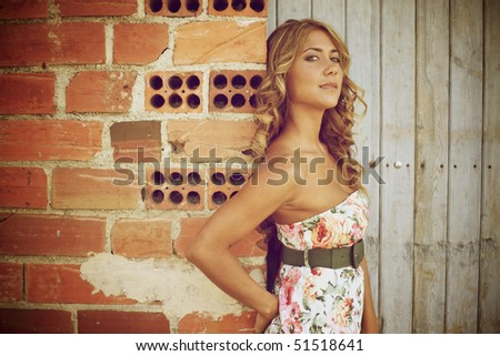 Blond woman looking at camera - stock photo