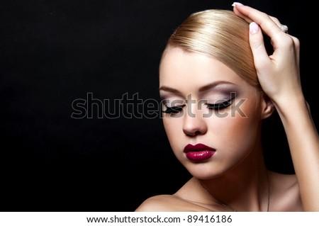 blond woman on black background - stock photo