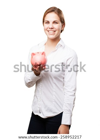 blond woman with a piggy bank - stock photo