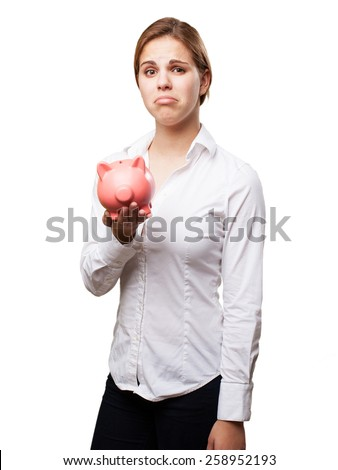 blond woman with a piggy bank. sad sign - stock photo