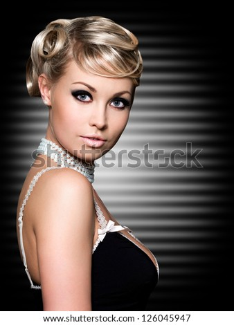 Blond woman with fashion beautiful hairstyle. Art background. - stock photo