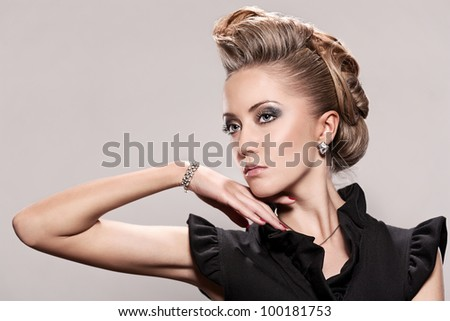 Blond woman with fashion hairstyle - stock photo