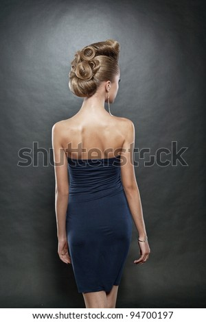 blond woman with fashion hairstyle, grey background - stock photo