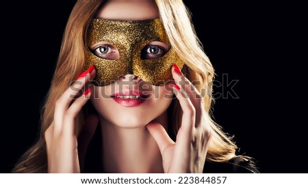 Blond Woman with Golden Mask in Low Key - stock photo