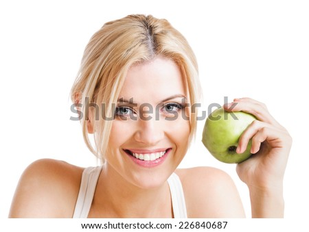 blond woman with green apple. on white background - stock photo