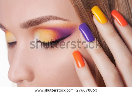Blond woman with manicure.Beautiful girl model with make-up and color nails.Nail design - stock photo