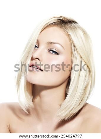 Blond woman with short sleek hair. - stock photo