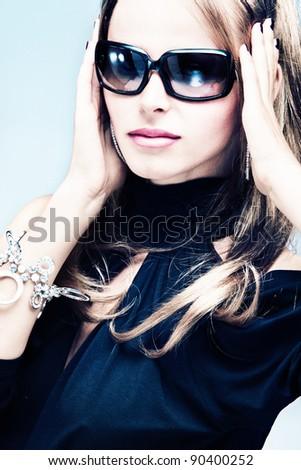 blond woman with sunglasses portrait, studio shot - stock photo