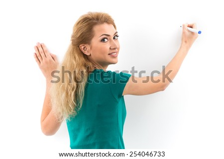 Blond woman writing on copyspace virtual screen. girl drawing on screen with blue marker on white background  - stock photo